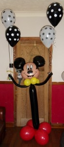 Mickey Mouse standing balloon display with helium balloons