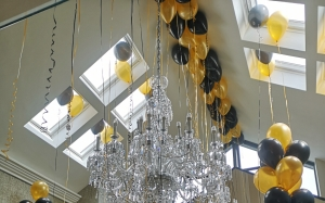 ceiling balloons, balloon bunches, black and gold balloons, helium balloons